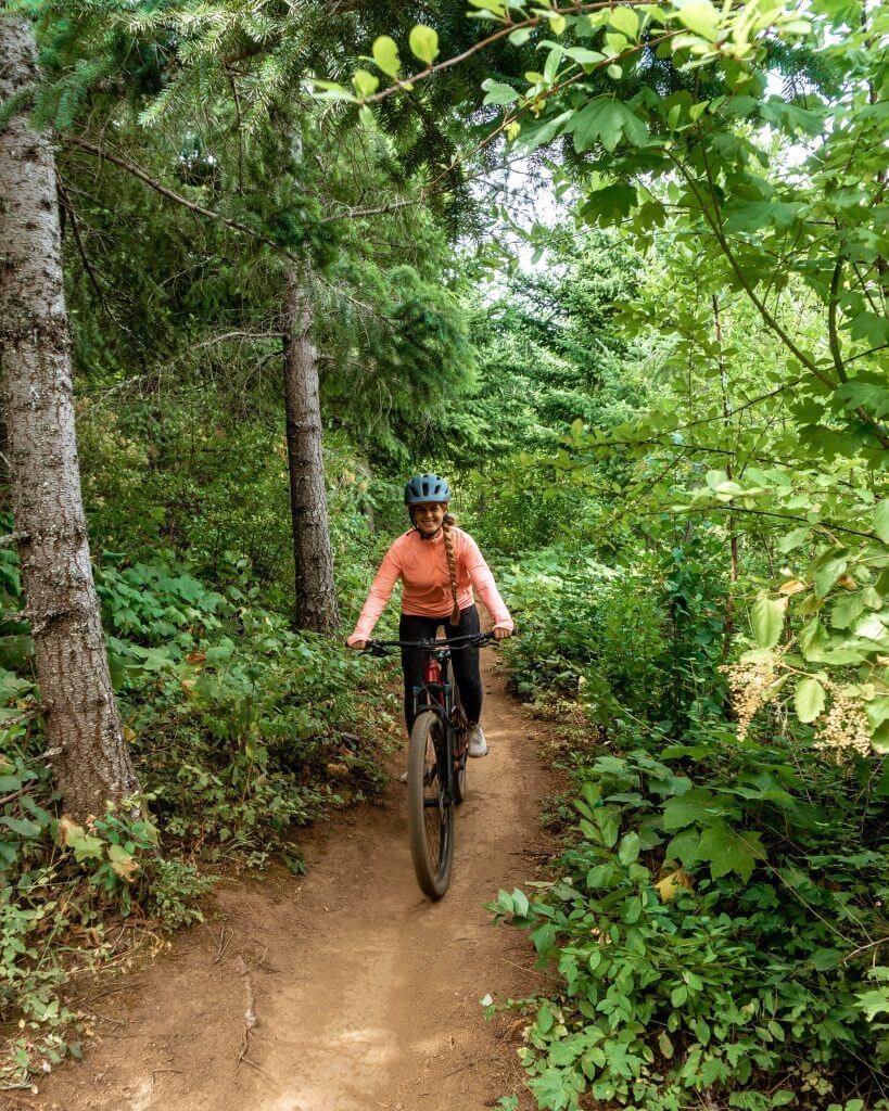 Jo Mountain biking on a trail in Hood River.