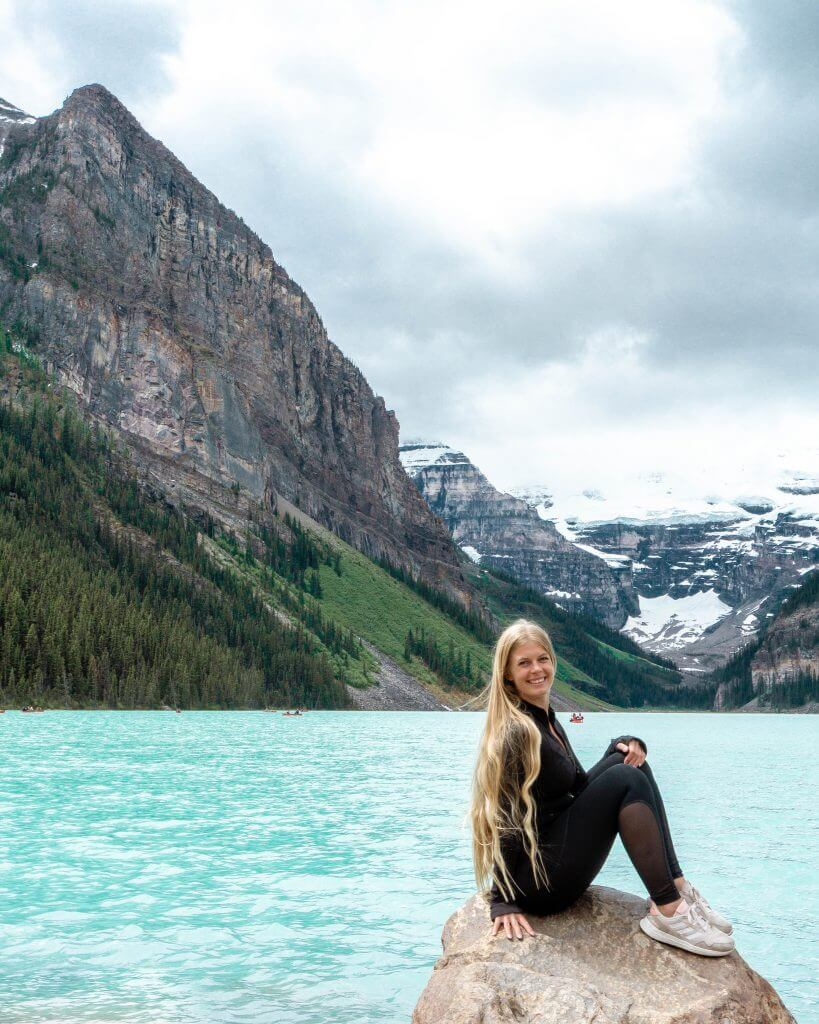 Jo smiling because she's out hiking in Alberta.