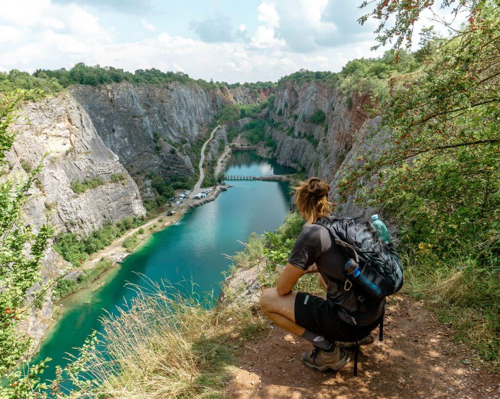 Photo of a guy standing in front of Velka Amerika quarry in the Czech Republic.