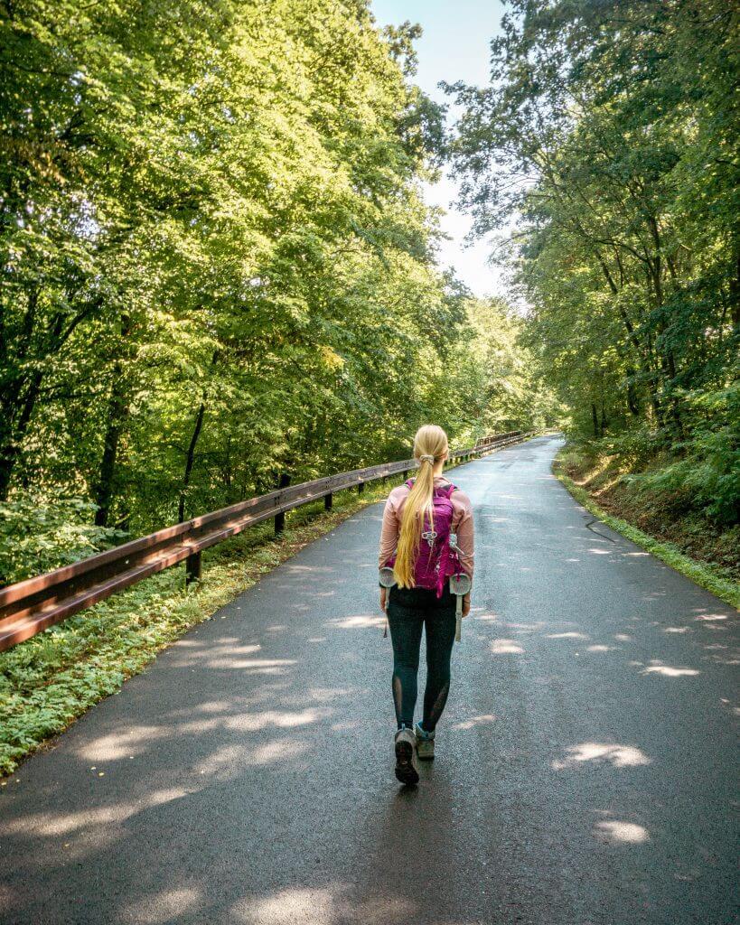 Jo walking on a road in Czech Republic.