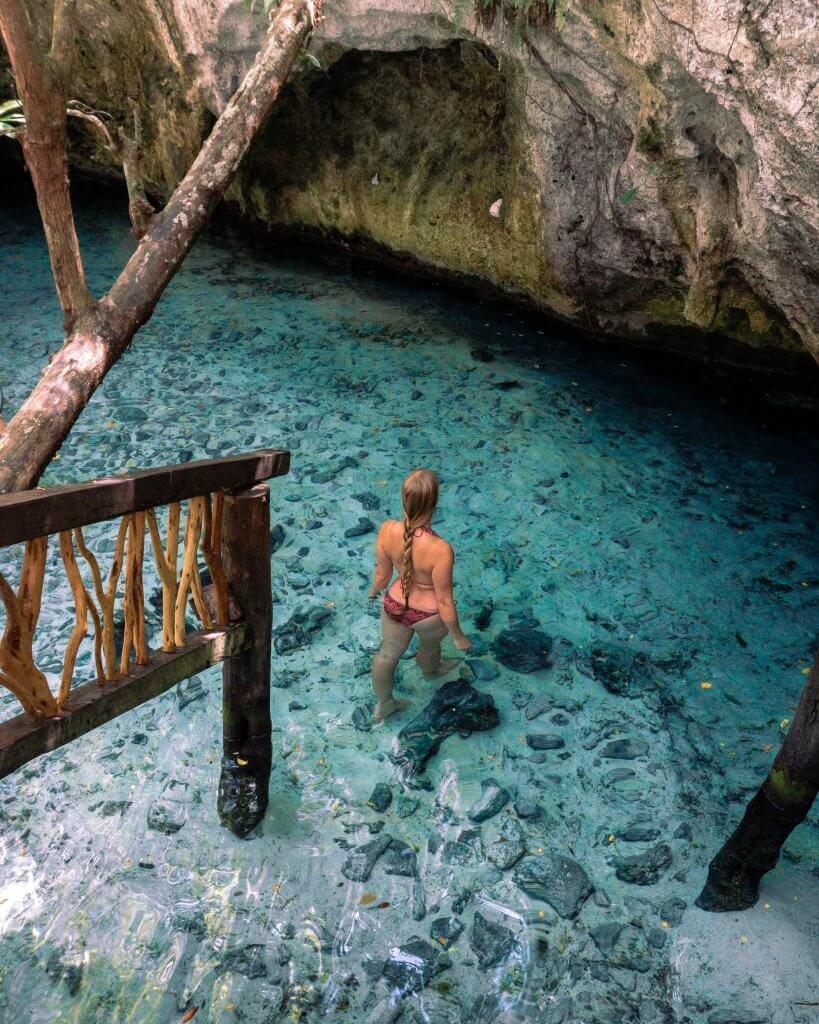 Jo swimming in a cenote in Mexico.