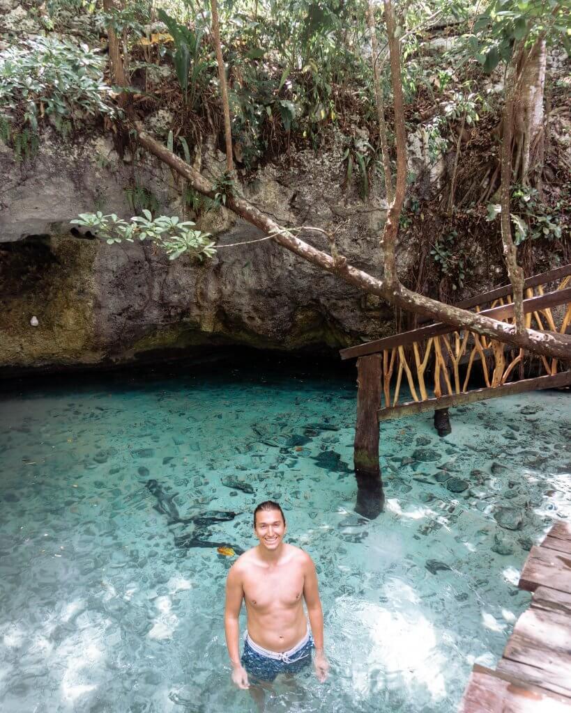 Dom swimming around Gran Cenote in Tulum.