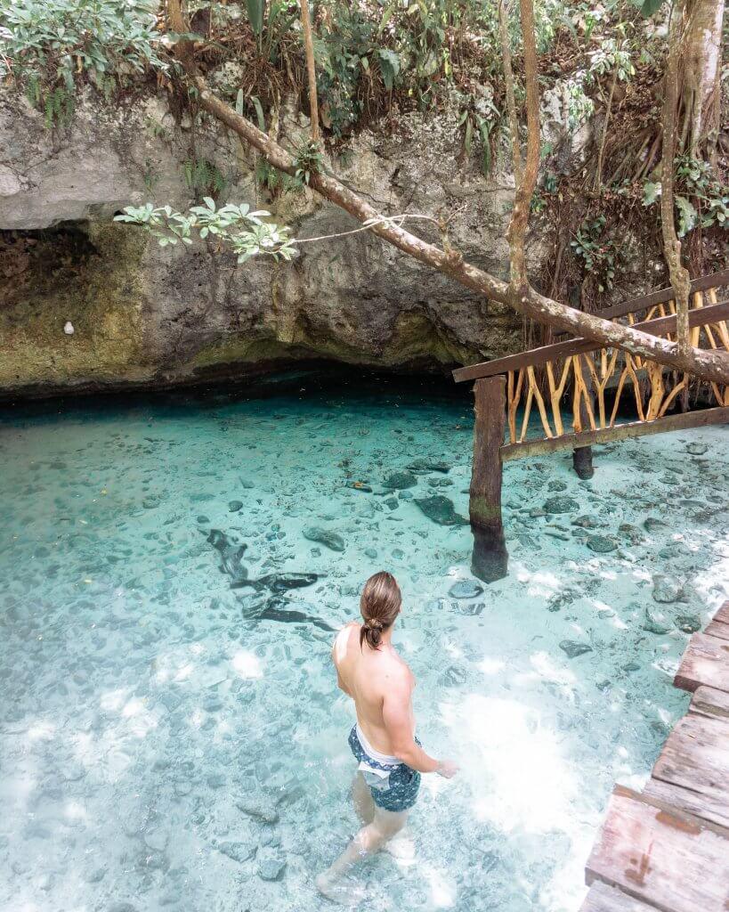 Dom exploring a cenote in Mexico.