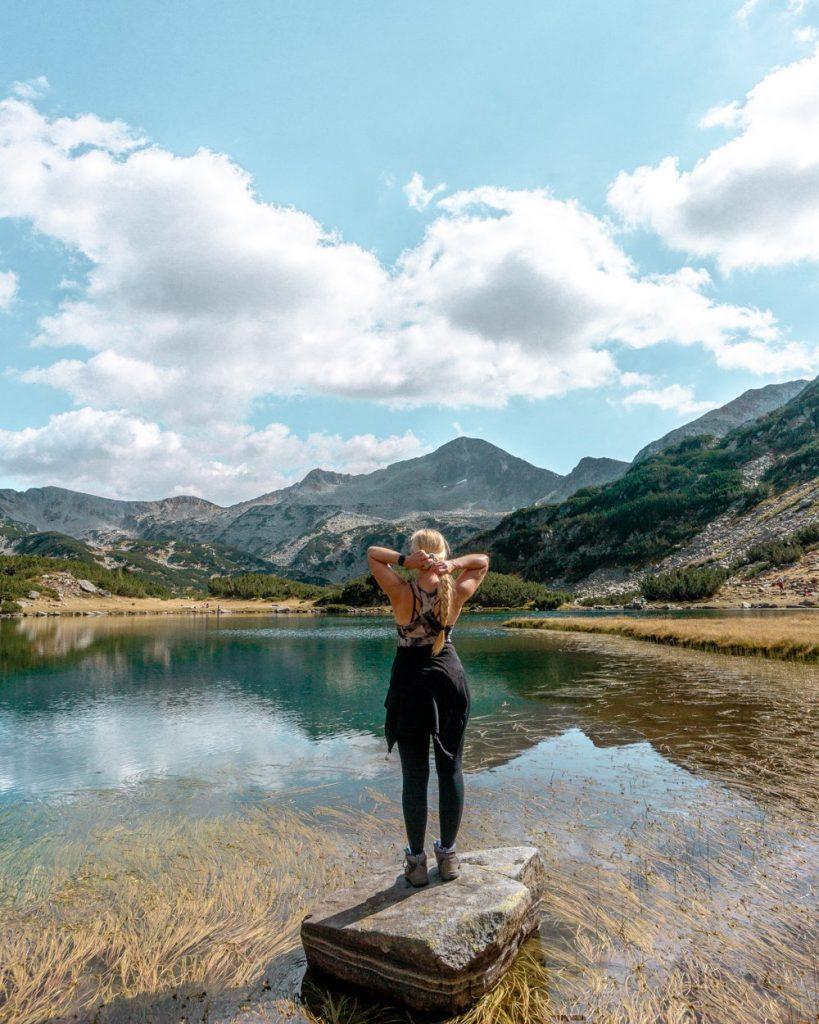 Jo taking in the views of an alpine lake in Bulgaria.
